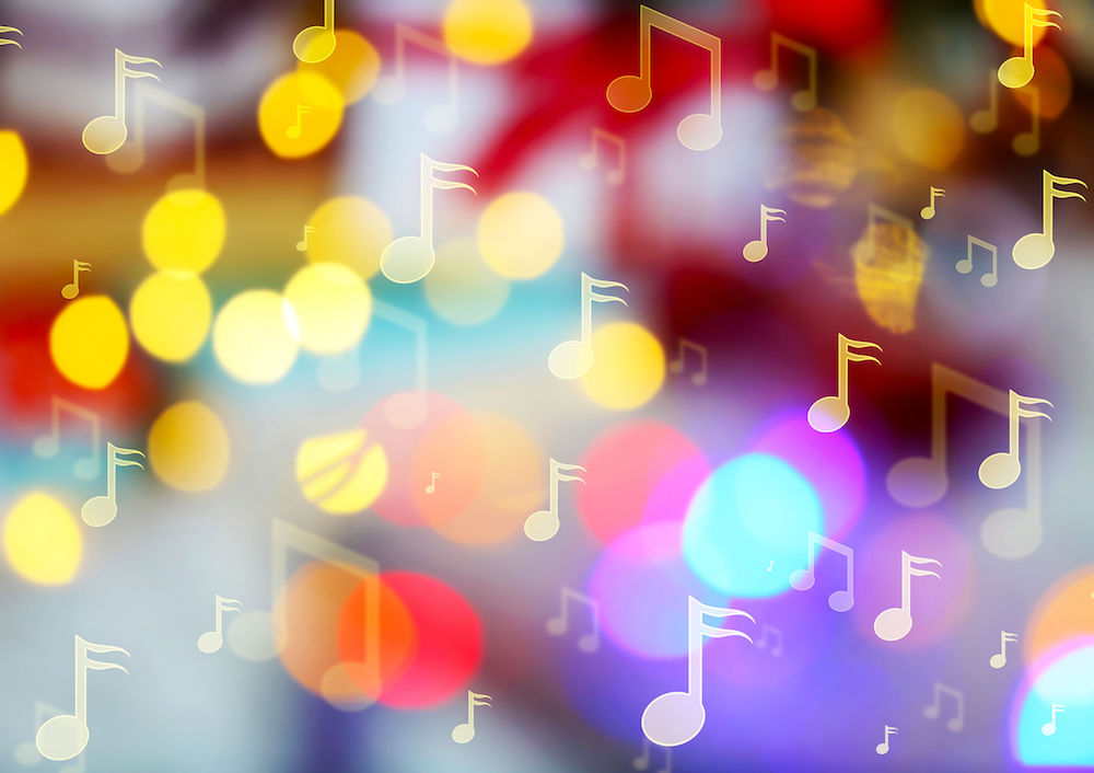 music notes on blurred lights background. christmas and new year 2018 celebration
