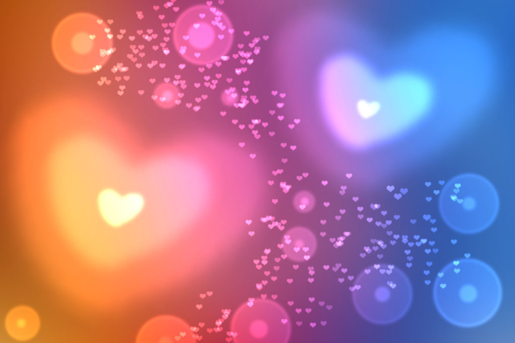 abstract colorful defocused, blurred heart shaped bokeh lights effect texture, background. universal wallpaper to valentine's day with blue, pink, yellow hearts. love, passion, feelings concept.